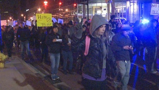 Hundreds of people marched in Grand Rapids on Saturday in reaction to Donald Trump being elected president.