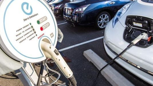 An electric car charges at Porter Nissan in Newark in 2013. Northern Delaware in November was designated an electric vehicle corridor by the U.S. Department of Transportation.