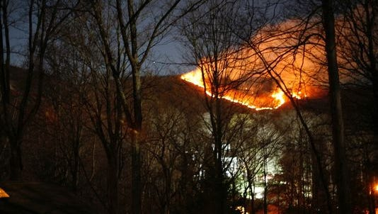 Flames can be seen from a forest fire in Harriman State Park (Rockland County, N.Y.) about 7 p.m. Sunday from Tranquility Road in the village of Wesley Hills, near the southwest corner of the park, about seven miles from the New Jersey border.
