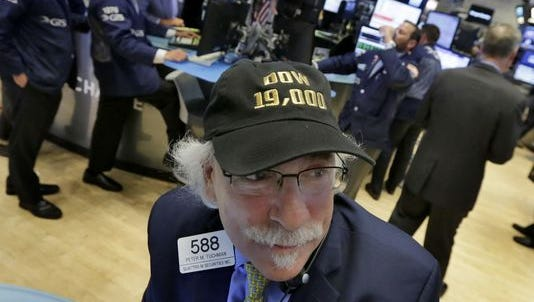 "Trader Peter Tuchman wears his ""Dow 19,000"" cap on the floor of the New York Stock Exchange."