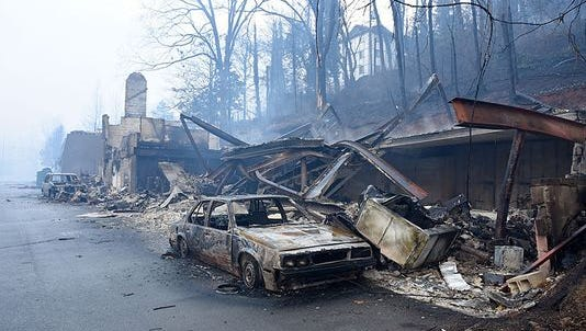 Wildfires burned multiple business and vehicles along Cherokee Orchard Road in Gatlinburg, Tenn., on Tuesday, Nov. 29, 2016.