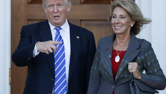 Donald Trump and Betsy DeVos in Bedminster, New Jersey, on Nov. 19.