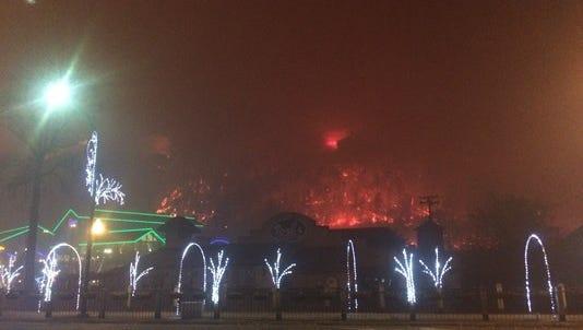 Fire engulfs the mountainside behind the Ripley's Aquarium of the Smokies in Gatlinburg.
