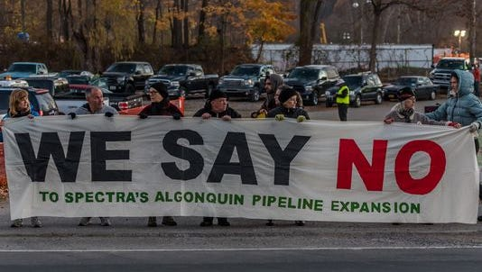 Opponents of Spectra Energy's Algonquin pipeline gathered near the construction site in Montrose on Nov. 10, some blocking the entrance to the project's wareyard. Nine people were arrested.
