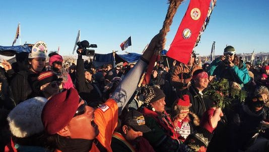 Protesters of the Dakota Access pipeline celebrate word Sunday that the project has been halted.