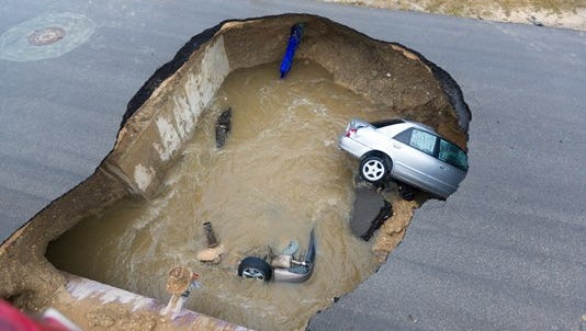 A Texas sheriff's deputy was killed after her car was swallowed by a sinkhole on Sunday night.