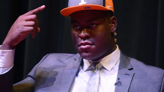 University School of Jackson senior Trey Smith points to a University of Tennessee cap after committing to the school Tuesday.