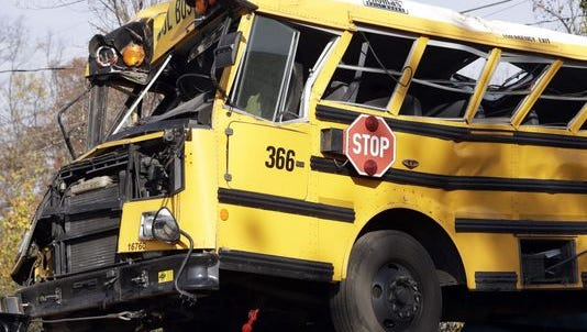 A crashed school bus is lifted away in Chattanooga.