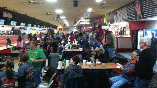 Members of the Muncie Fire Dept. and family and friends fill Munsee Lanes during a past Bowling for Kids fundraiser.