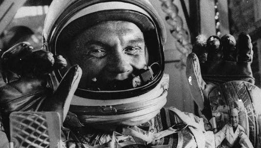 Astronaut John Glenn displays his three reflection mirrors in preparations for space flight from Cape Canaveral in this Jan. 21, 1962 file photo.