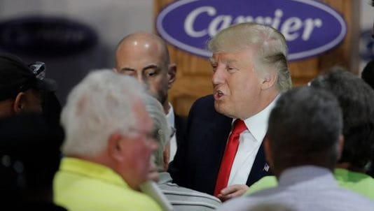 In this Dec. 1 file photo, Donald Trump talks with workers at Carrier Corp. in Indianapolis,