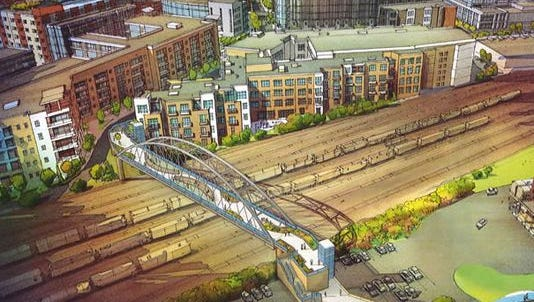 """A recent rendering of a planned pedestrian bridge connecting the Gulch and SoBro neighborhoods shows an arch design. Public Works officials say it is a """"starting place"""" for discussion on a final design."""