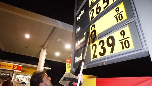 Lou Franco, owner of P.E.P. Service Center in Oceanport, N.J., changes the gas price sign ahead of another increase.