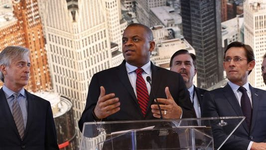 U.S. Transportation Secretary Anthony Foxx speaks as auto executives listen at the North American International Auto Show in Detroit.