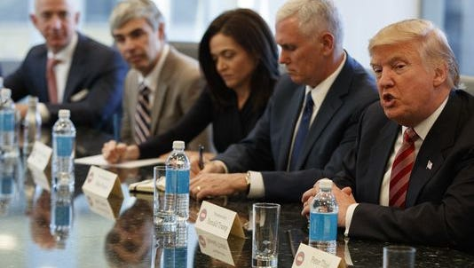 Donald Trump speaks during a meeting Wednesday at Trump Tower in New York with technology industry leaders, including Amazon founder Jeff Bezos (from left), Alphabet CEO Larry Page, Facebook COO Sheryl Sandberg, Vice President-elect Mike Pence.