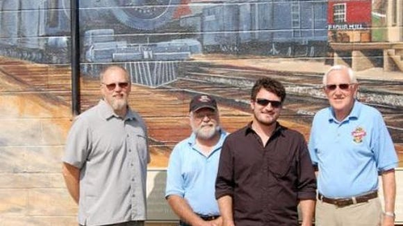 "John ""Otts"" Hufnagel, second from left, is seen with others instrumental in the painting of the mural of Glen Rock's past as key stop on the railroad."