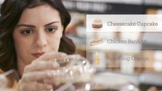A screen shot from a promotional video by Amazon about Amazon Go, it's pick up and go shopping prototype story.
