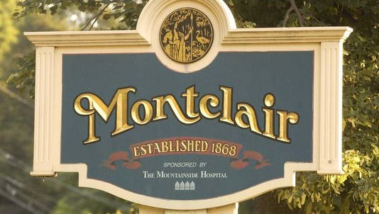A large welcome sign graces the Grove Street northern border of Montclair.
