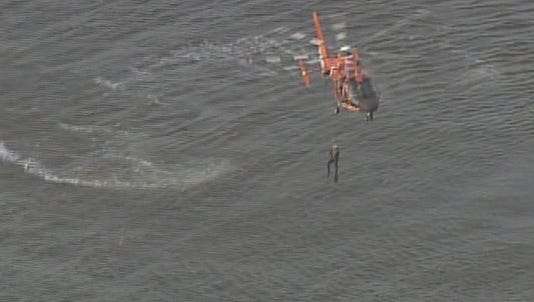 "U.S. Coast Guard rescue crew hovers over area where ""military grade"" helicopter crashed off El Jardin Beach in Seabrook, Texas, Wednesday afternoon."