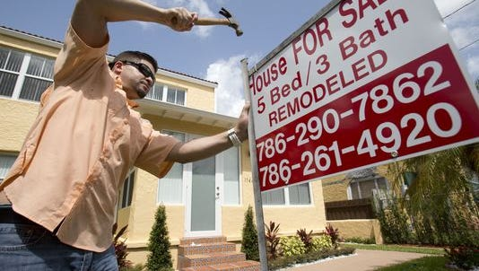 The housing market is expected to pick up moderately next year on steady job and income growth and an easing supply crunch, but rising mortgage rates are likely to temper the gains, economists say.