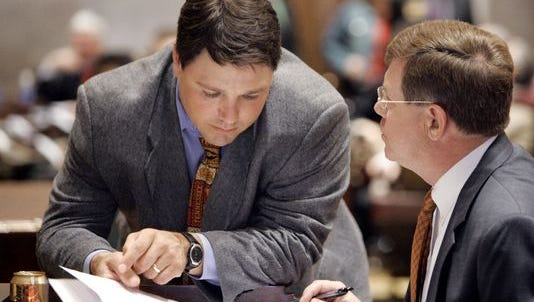 FILE - Joe McCord, left, talks with  Rep. Mike McDonald, D-Portland, in 2007.