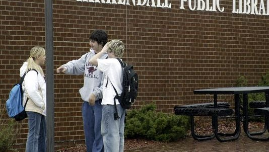 Teens outside the Kirkendall Public Library in Ankeny.