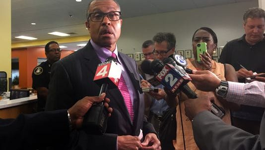 Detroit Police Chief James Craig speaks with reporters.