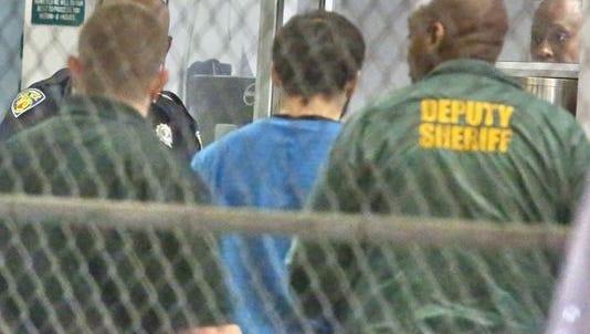 Esteban Santiago is taken into custody in Fort Lauderdale on Jan. 6.
