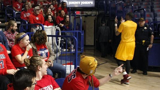 ASU's Torian Graham gestured to fans after pregame warmups on Thursday night.