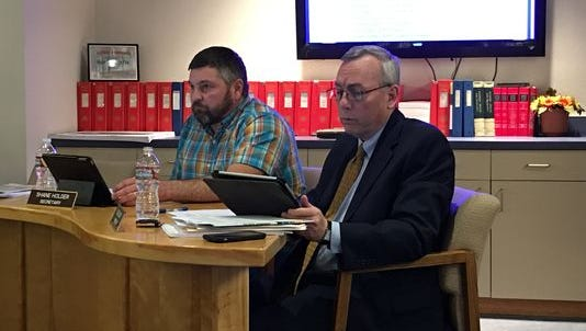 Greg Cory, right, leads a meeting of the Ruidoso school board. Cory will be moving to El Paso to head Las Cruces-based Western Heritage Bank.