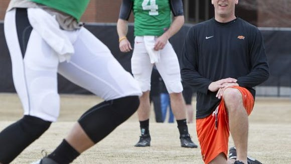 Oklahoma State offensive coordinator Mike Yurcich running
