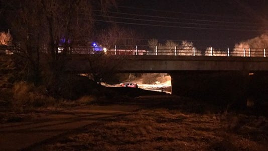 A man is in custody after a chaotic incident that police say began with an SUV submerged in a river – and ended with a good Samaritan's stolen Cadillac leading police on a pursuit.