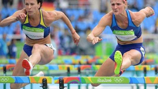 St. Cloud State graduate Heather Miller-Koch (left) competes in the hurdles as part of the women's heptathlon at the Summer Olympics in Rio last August.