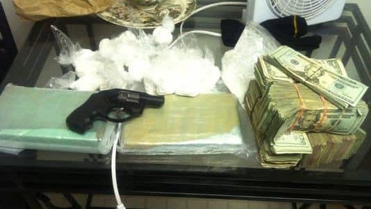 Pictured here is evidence seized from a Feb. 27, 2011 raid at a Southfield apartment, where 2 kilos of cocaine, cash and a gun were seized. Prosecutors allege Lt. David Hansberry and his crew stole some of the money seized in the raid.