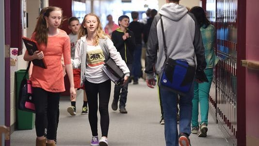 Students walk through a hallway at Wellington Middle School on March 22, 2016. Poudre School District plans to build a combined middle/high school in Wellington to address crowding in Wellington-area schools and others.