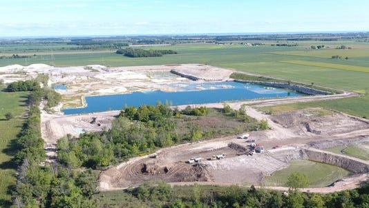 Ottawa County Judge Bruce Winters issued a restraining order Thursday against Rocky Ridge Development LLC from dumping industrial waste at its Graytown quarry.