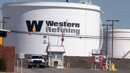 Five Western Refining shareholders want to end their lawsuits against its merger with Tesoro Corp., but want the companies to pay attorney's fees and other costs.