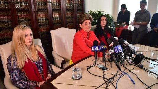 ourview030917  Marine Lance Cpl. Marisa Woytek, left, and attorney Gloria Allred in Los Angeles on March 8.