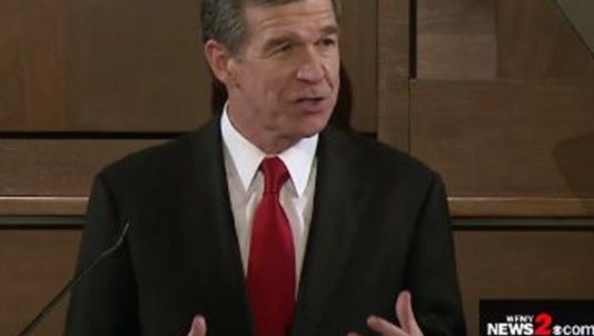 Gov. Roy Cooper addresses members of the General Assembly during his inaugural State of the State address March 13.