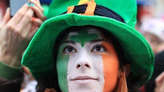 A parade-goer watches a float during the St. Patrick's Day festivities in Dublin on March 17, 2012.