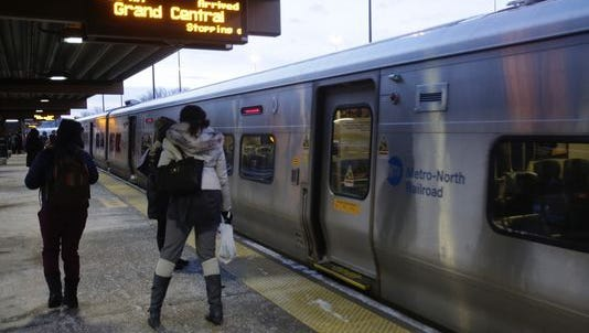 Commuters head for the Metro-North train to Grand Central Terminal at the Metro-North Croton-Harmon train station in Croton-on-Hudson on March 15, 2017.