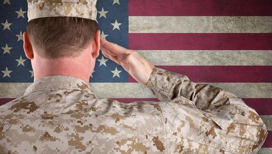 Marine Salutes an American Flag