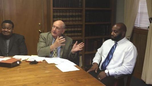 From left: Law clerk Adam Andrews, attorney Julian McPhillips, former corrections officer Cornelius Simpson.