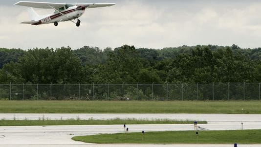 A plane takes off in 2011 from Purdue University airport.
