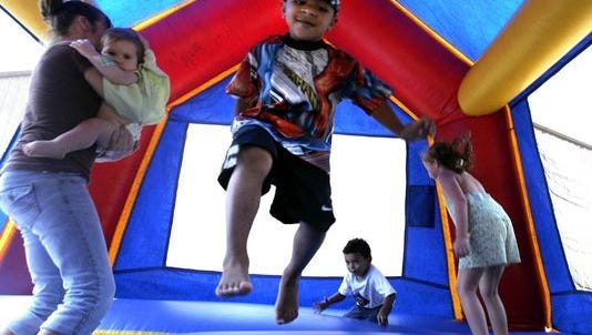 In this 2005 file photo, children play in a bounce house in Vidor, Texas