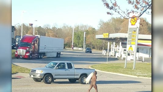 Motorists posted several photos on Twitter of a naked man with a bag over his shoulder strolling through traffic on Jefferson Avenue last week.