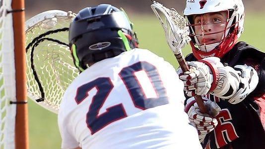 Boonton senior attackman Austin Van Zant beats North Warren goalkeeper Chris Santamaria to score his 100th career goal.