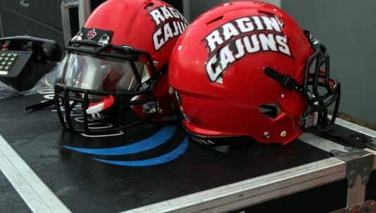 A group of 13 Ragin' Cajun football players have been charged with felony conspiracy to commit theft.