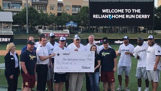 The Dallas Cowboys present check to The Salvation Army after raising $50,000 at their sixth annual Reliant Home Run Derby.  Head coach Jason Garrett won the derby.