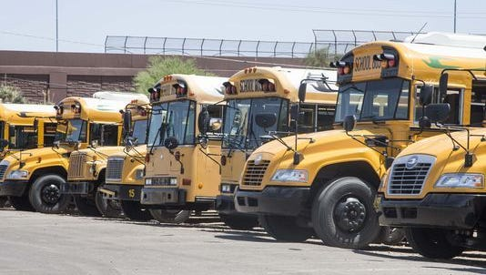 School buses are lined up at Canyon State Bus Sales in Glendale.
